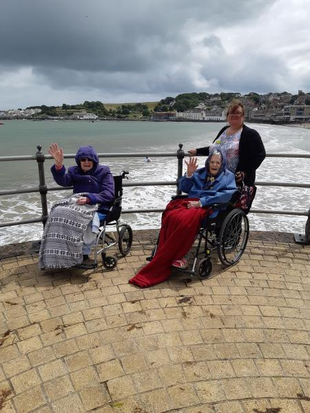 The Wimborne Care Home, Dorset-Residents Sonia and Joan with Nurse Caroline on the promenade at Swanage