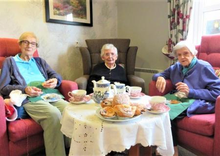 Westbury Court Care Home, Wiltshire-Residents Lois, June and Marjorie enjoying the danish pastries at our Magic Moments Cafe