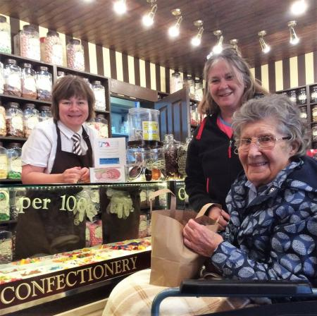 A resident at Kingsmills Care Home in Inverness visits an old fashioned sweet shop
