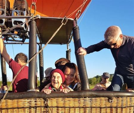 Muriel with Charlene Beck the home manager in the hot air balloon