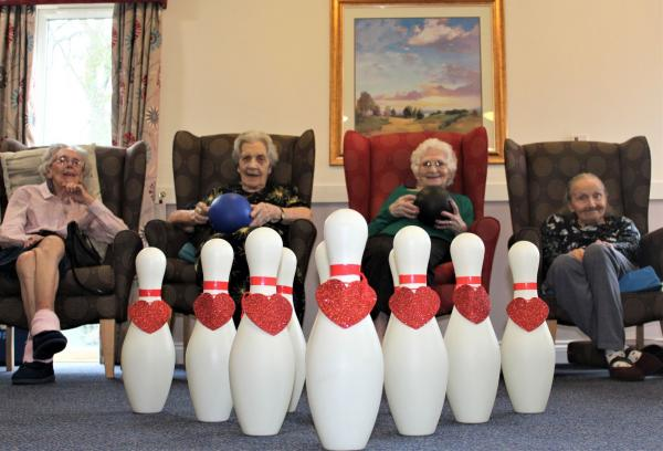 Ashbourne Court Care Home, Hampshire-Residents Margaret, Pam, Edith and Irmgard are 'bowled over' on Valentine's Day!