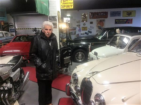 Peter exploring the classic cars on display at Bo'ness Motor Musem