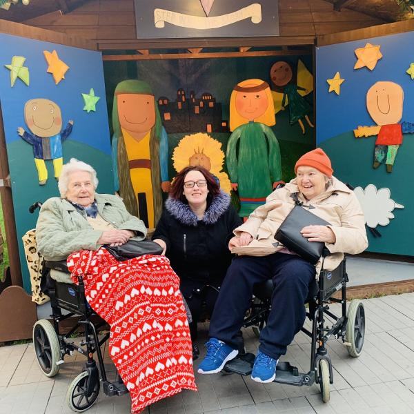 Resident Betty, Magic Moments Club Coordinator Katie and resident Doreen at Winchester Christmas Market