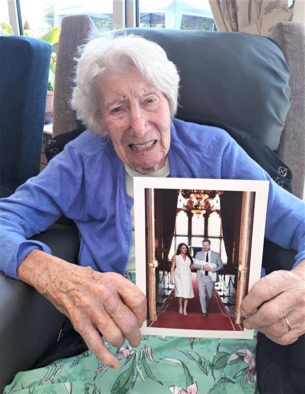 Highfield Care Home, Ware-Resident Lillian with the thank you card we received from the royal couple