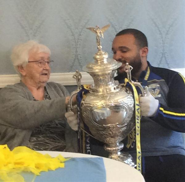 St Oswalds House Care Home, Cheshire-Resident Joyce admiring The Challenge Cup