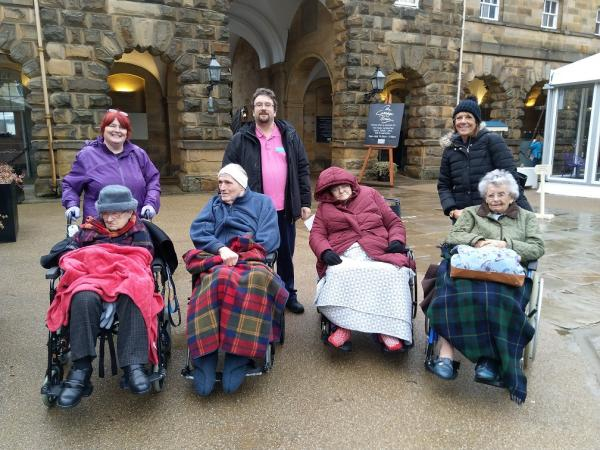 Residents Jean, Ken, Carol and Elizabeth with volunteer Val and team members James and Caroline in the courtyard at Chatsworth House