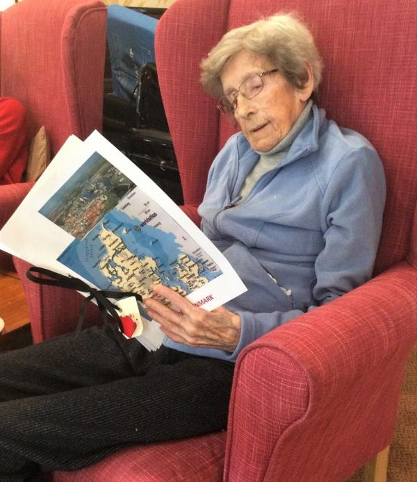 The Lawns Care Home, Oadby-Gerda looking through the scrapbook that Magic Moments Club Coordinator Jackie made for her