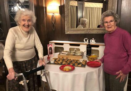 Hungerford Care Home in Berkshire. Residents enjoying a 'girls night in' sampling lovely Chinese food with a few drinks and music! Audrey and Elizabeth look forward to tasting the offerings!