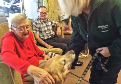Residents Marjory and Bill enjoy meeting Brenda and Drummer