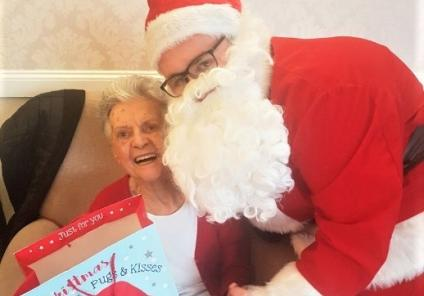 Clarence Court had a special visit from Father Christmas! Mary is delighted with her gift