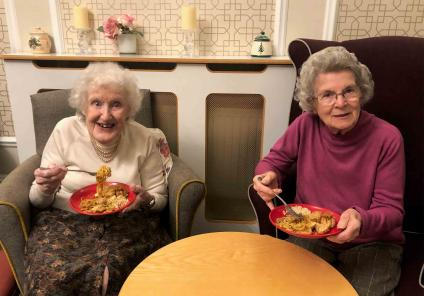 Hungerford Care Home in Berkshire. Residents enjoying a 'girls night in' sampling lovely Chinese food with a few drinks and music! Audrey and Elizabeth ready to tuck in