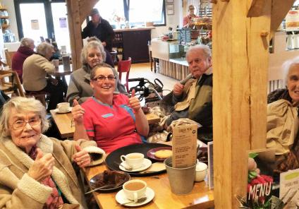 Everybody enjoying tea and cake in the cafe!