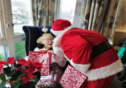 Clarence Court had a special visit from Father Christmas! Irene saying thanks for her present