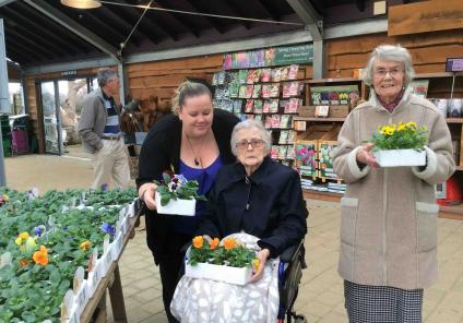 Residents Valerie and Hazel and team member Lisa choosing their flowers for our garden!