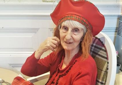 Resident Helen sports a tartan cap complete with ginger locks!