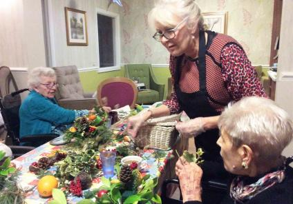 Florist Karen teaches everybody how to make the table decorations