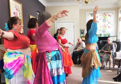 Alanya and her dance troupe perform a belly dancing demonstration for the residents