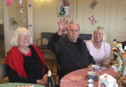 Resident Malcolm Bussay enjoying the tea party with members of his family
