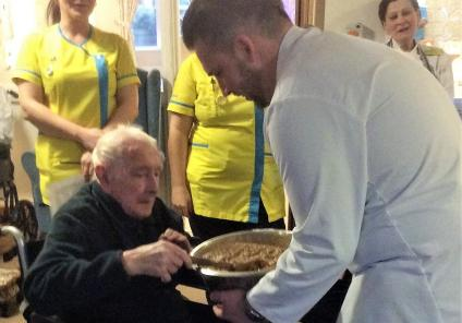 Albany Care Home, Oxfordshire. Resident Charles Hayday helping Chef Marek Klisky mix our Christmas cake
