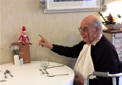 Albany Care Home, Oxfordshire. Resident Giovanni tells our naughty elf to behave at the dinner table!