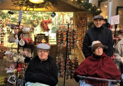 Albany Care Home, Oxfordshire. Residents David Green and Angela Cusden with her husband Allan at Oxford Christmas Market