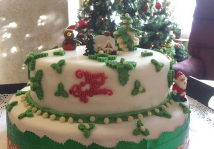 Albany Care Home, Oxfordshire. The wonderful Christmas cake made by our residents along with our Chef Marek Klisky
