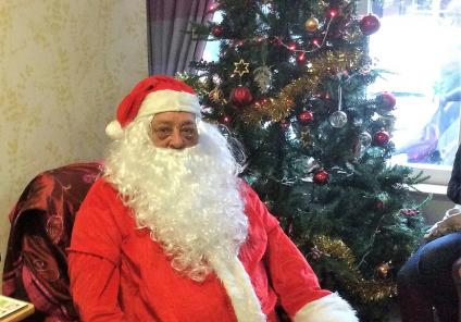 Albany Care Home, Oxfordshire. We welcomed Father Christmas with boxes and boxes of presents for everyone!