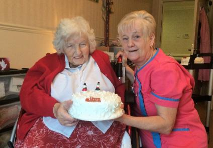 Avery House Care Home, Peterborough. Resident Rose Bowd and Magic Moments Club Assistant Deb Andrew with one of the fabulous Christmas cakes our residents made this year