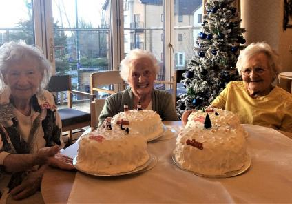 Avery House Care Home, Peterborough. Residents Viv Burgh, Trudi Charnock & Iris Clarke with this year's homemade Christmas cakes
