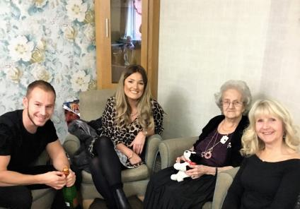 Bamfield Lodge Care Home, Bristol. Resident June Ball surrounded by her family on Christmas Day