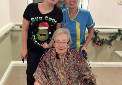 Bamfield Lodge Care Home, Bristol. Resident Nora Lowther with team members Iryna Dunk and Tracey Sullivan on Christmas morning