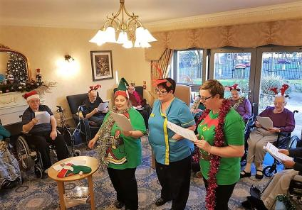 Broadway Halls Care Home, Dudley. Residents and team members enjoying a festive sing-song