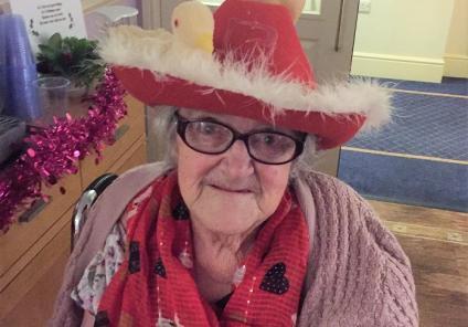 Cepen Lodge Care Home, Chippenham. Resident Margaret sporting her two turtle doves Christmas hat