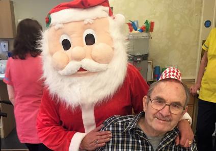 Cepen Lodge Care Home, Chippenham. Resident Patrick with Santa enjoying Christmas Day