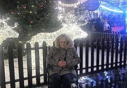 Clarence Court Care Home, Glasgow. Resident Sarah Pettigrew enjoying a trip out to see the amazing Christmas lights in Glasgow's George Square