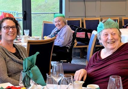 Flowerdown Care Home, Winchester. Family member Rachel with residents Doreen and Sheila attending the Stroke Club Christmas lunch at The Royal Winchester Golf Club on 17th December