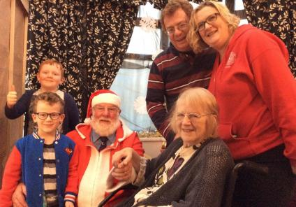 Henleigh Hall Care Home, Sheffield. Resident Christine Alison Doubleday and family with Father Christmas