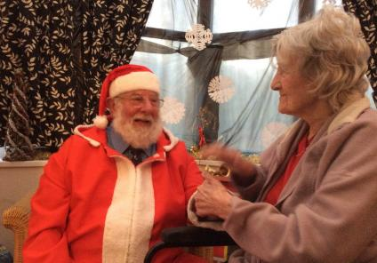 Henleigh Hall Care Home, Sheffield. Resident June Bell meeting Santa at our Christmas market