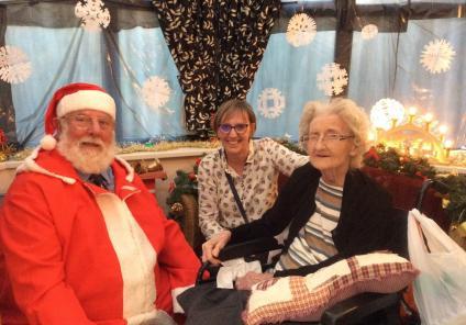 Henleigh Hall Care Home, Sheffield. Resident Pamela Gilson and her daughter meeting Santa