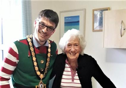 Highfield Care Home, Hertfordshire. The Mayor of Ware, David Oldridge, came to visit on 21st December. Pictured with resident Jean Gunning