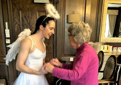 Hungerford Care Home, Berkshire. Resident Elizabeth Earl enjoying a boogie with one of the Golden Toes dancers who came to perform their Christmas show on 21st December