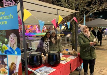 Hungerford Care Home, Berkshire. Team members Kanika Sharma, Aanchal Sharma and Ana Jesus attending the Hungerford Town annual Christmas Extravaganza giving out festive treats to our local community
