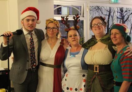 Ivybank House Care Home, Bath. A festive singalong; Singer Jordon with team members Kashia, Shavana, Michele and  Debbie