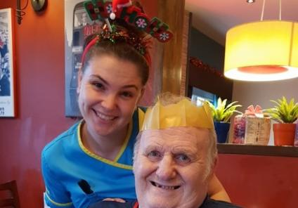 Ivybank House Care Home, Bath. Resident Mike Burgess with Carer Rachel Rodd at our Christmas meal out