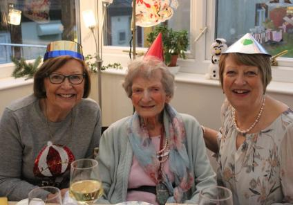 Ivybank House Care Home, Bath. Resident Sybil Showering and her daughters enjoying a festive meal together