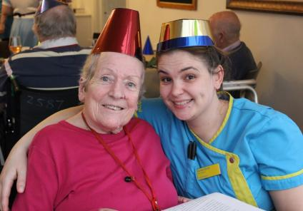 Ivybank House Care Home, Bath. Resident Val Welch and Carer Rachel Rodd at our Christmas party