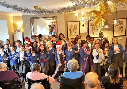 Kingston Care Home, Surrey. A wonderful carol concert at our home by pupils from Coombe Hill Junior School on the 17th December