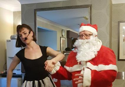 Kingston Care Home, Surrey. Entertainer Katie Lewis and Santa at our Christmas party on 8th December