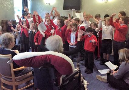 Leeming Bar Grange Care Home, North Yorkshire. Aiskew Leeming Bar Primary School pupils visited to sing festive songs to us on 14th December