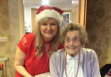 Leeming Bar Grange Care Home, North Yorkshire. Chrissie Plant, Landlady of The Nags Head Pub surprised our residents with gifts this Christmas. Here she is pictured with resident Jean